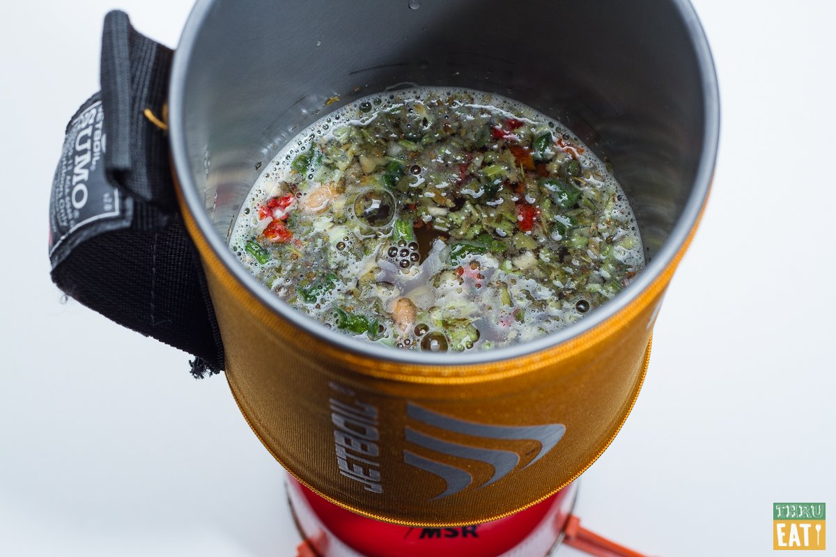 Backpacking minestrone soup cooking in a Jetboil