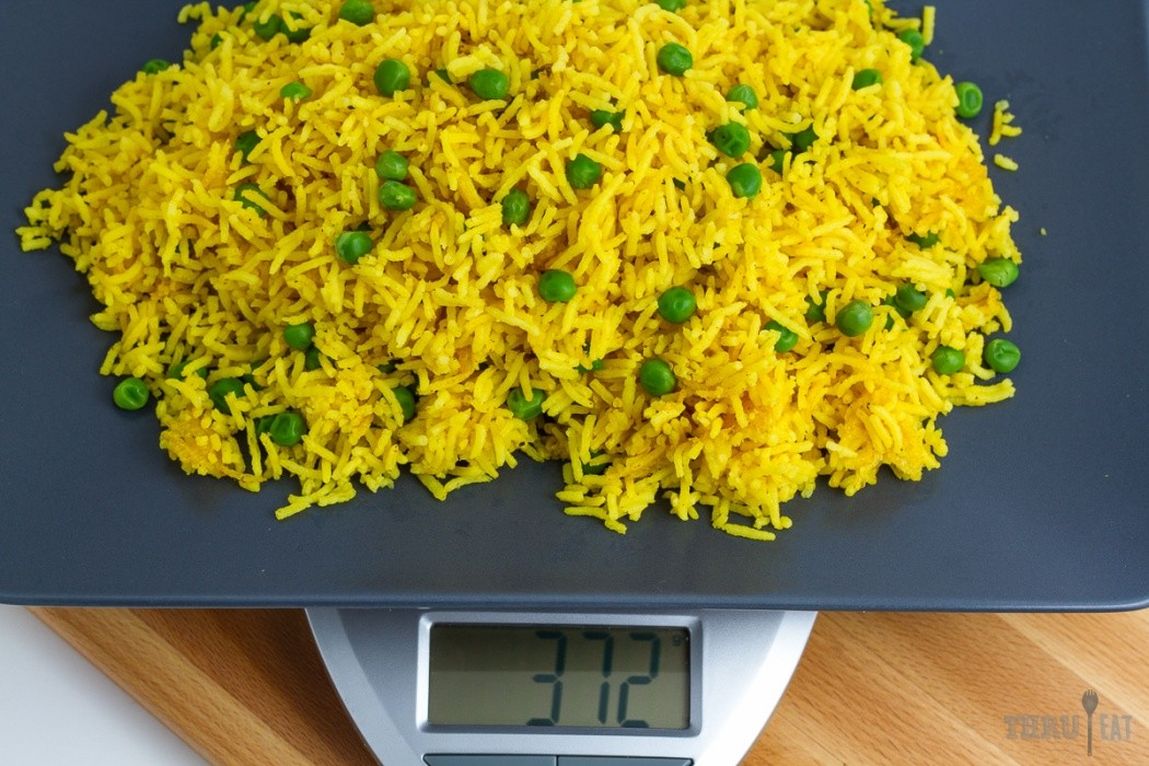 golden basmati rice on a scale