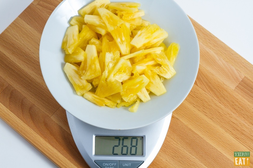 sliced pineapple on a food scale