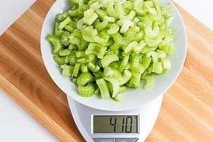 410 grams of chopped celery on a scale