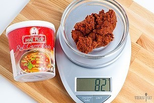 82 grams of red curry paste on a scale