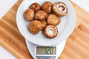 120 grams of baby bella mushroom on a scale